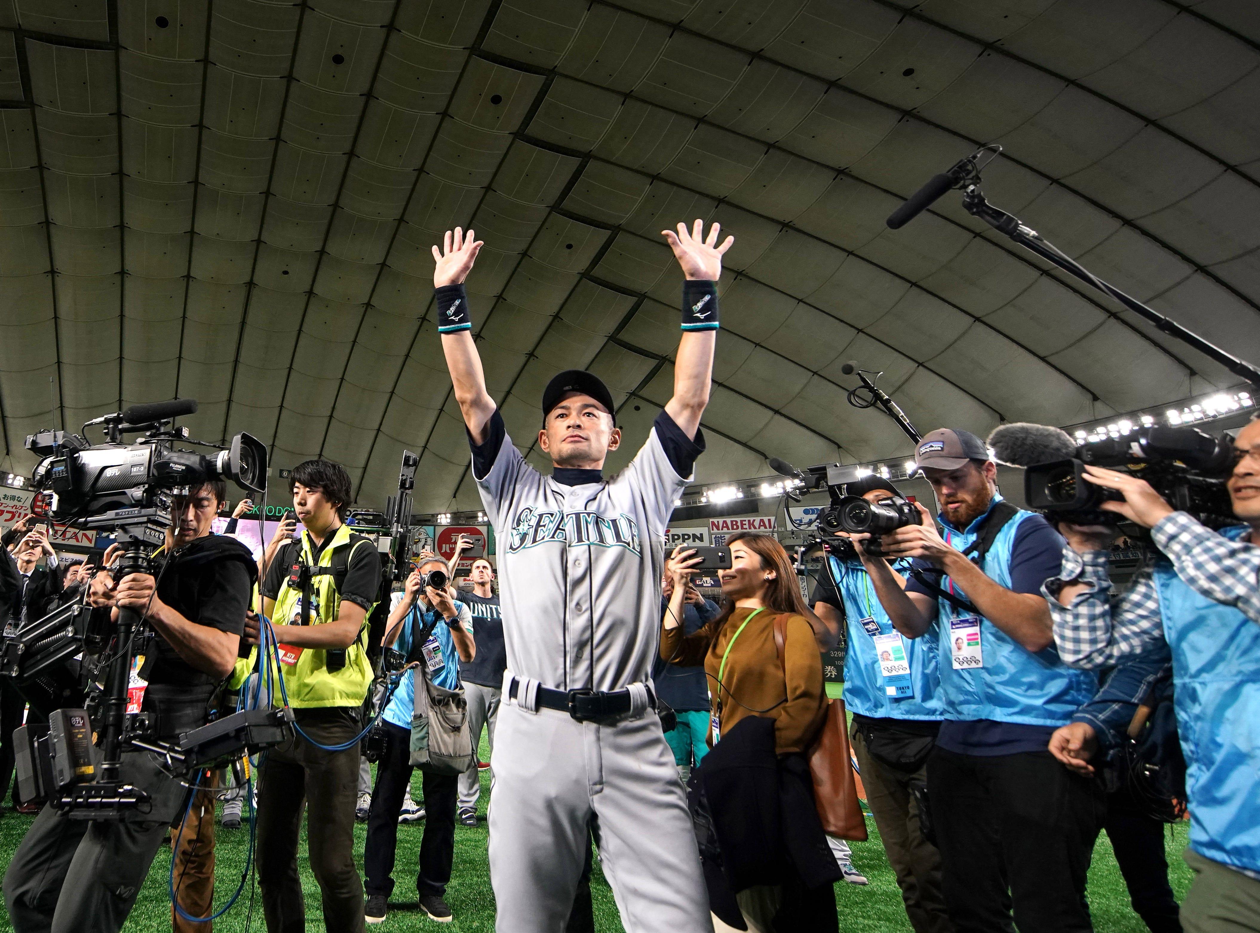 March 21: Ichiro Suzuki waves to fans after Seattle's game against Oakland in Tokyo.