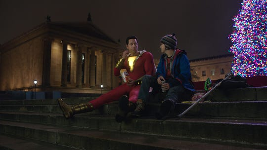 "Supersized Billy Batson (Zachary Levi, left) and foster brother Freddy Freeman (Jack Dylan Grazer) take a junk-food break on the ""Rocky"" steps of the Philadelphia Museum of Art in ""Shazam!"""