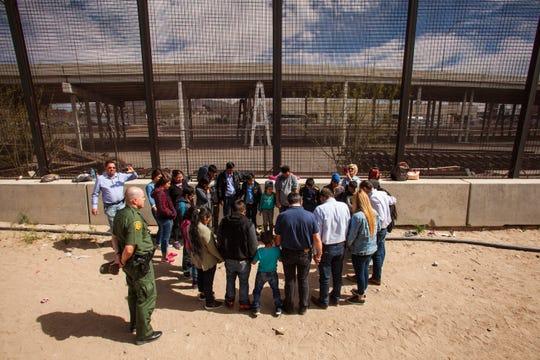 Evangelical pastors pray with migrants from Honduras, Guatemala and El Salvador in El Paso, Texas, on March 28, 2019.