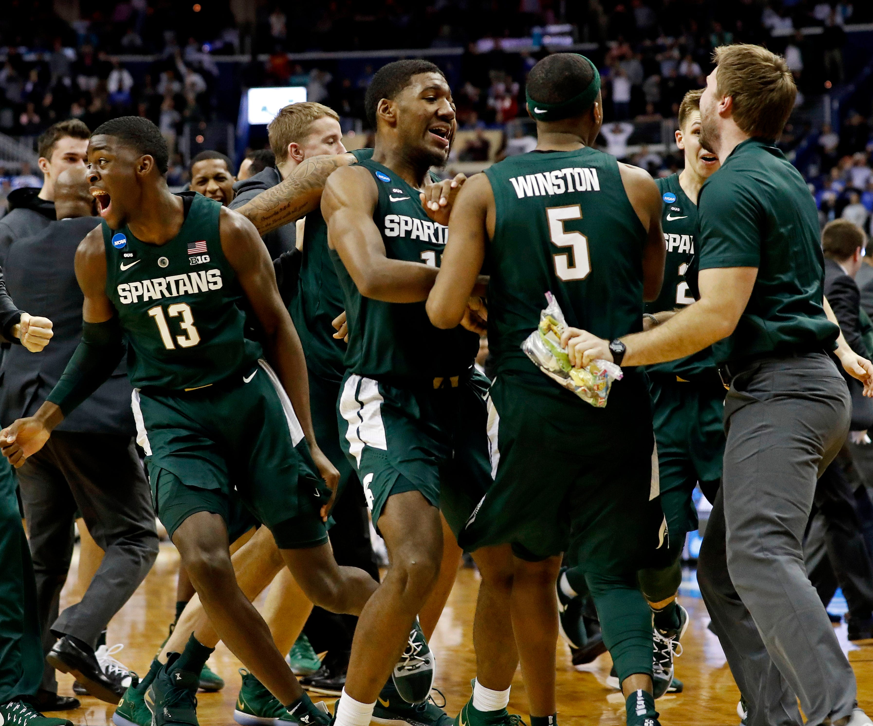 Michigan State players celebrate after beating Duke in the East Regional championship game of the 2019 NCAA tournament.