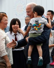 Then-Vice President Joe Biden with survivors of an earthquake and tsunami in Natori, Japan, in 2011.