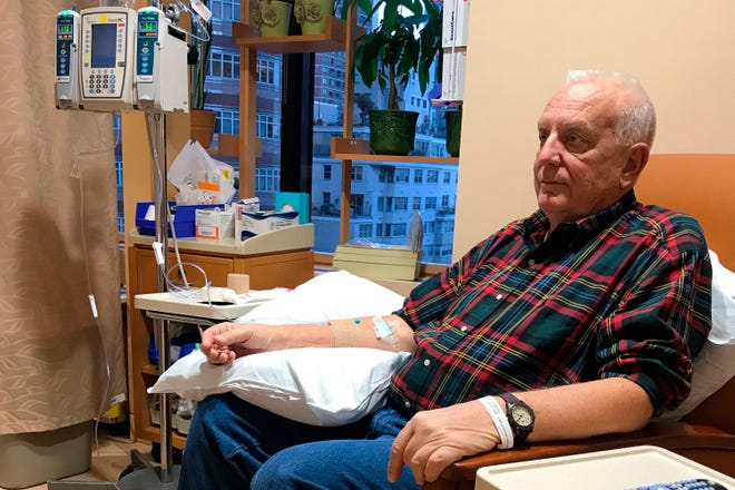In this Dec. 11, 2017 photo provided by Anna Carlstrand, her husband, Richard, receives the first of 20 Keytruda infusions at Memorial Sloan Kettering Cancer Center in New York. Carlstrand, 76, of Long Key, Florida, underwent the immunotherapy treatment for mesothelioma, an aggressive cancer of the lining of the lungs, and is now in remission.