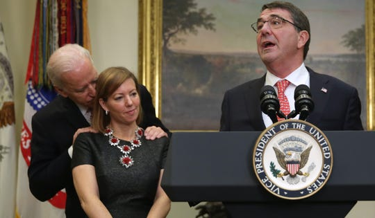 Ashton Carter, right, makes remarks after he was sworn in as Secretary of Defense, as his wife Stephanie and Vice President Joe Biden listen in the Roosevelt Room of the White House in Washington, Feb. 17, 2015