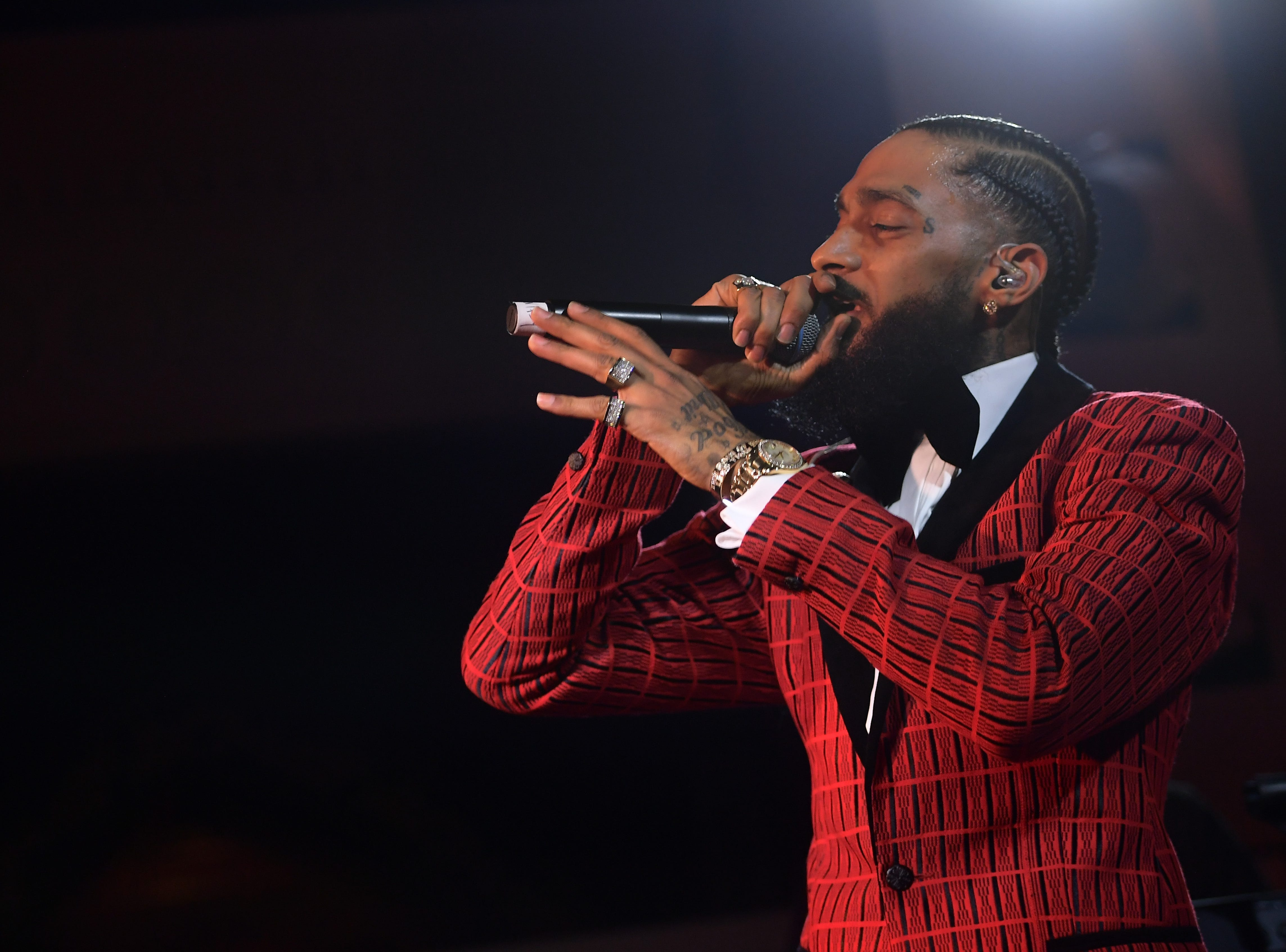 Nipsey Hussle performs onstage at the Warner Music Pre-Grammy Party at the NoMad Hotel on Feb. 7, 2019, in Los Angeles.