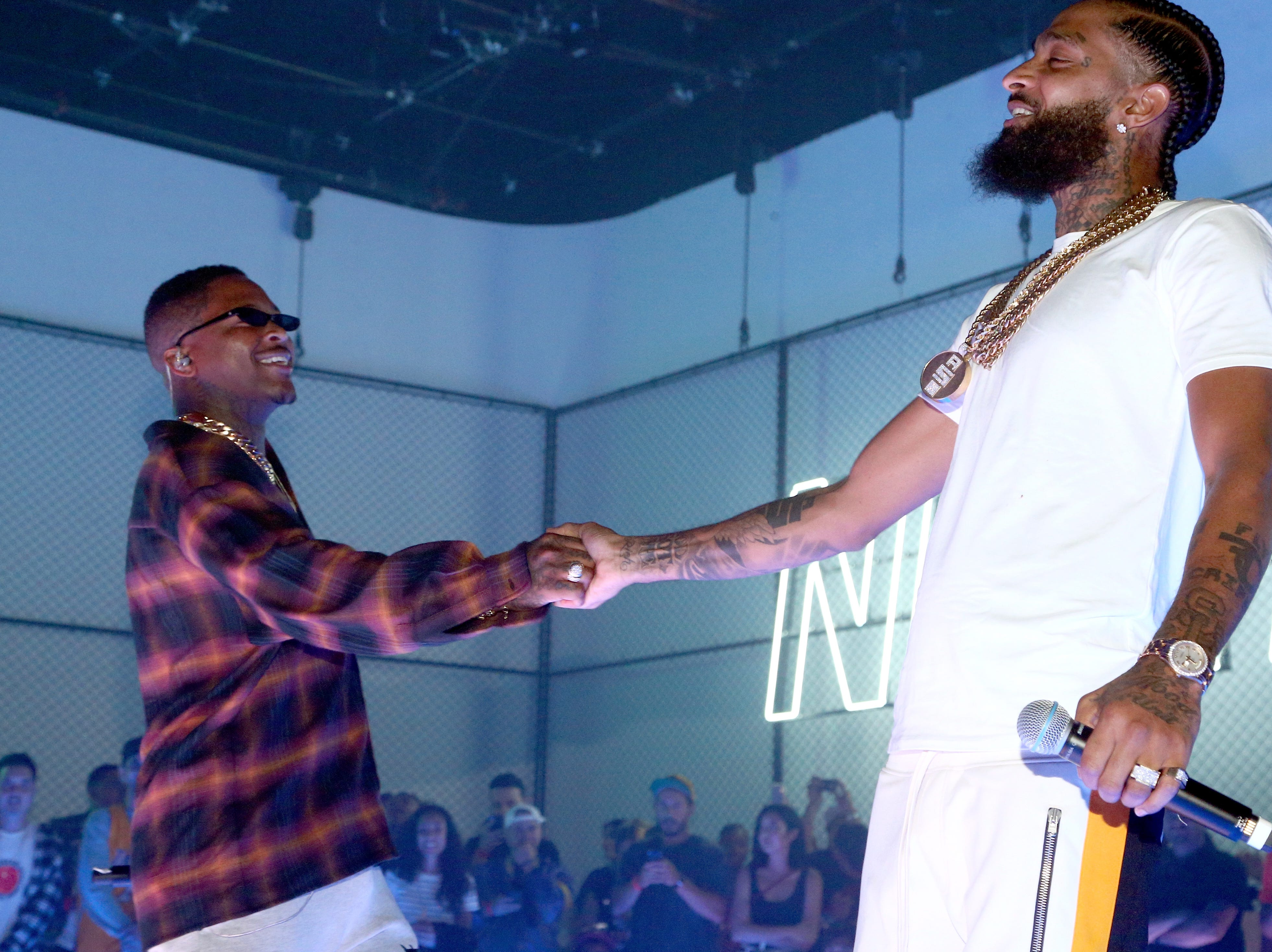YG, left, and Nipsey Hussle perform during EA SPORTS NBA Live 19 at Goya Studios on Aug. 24, 2018, in Los Angeles.