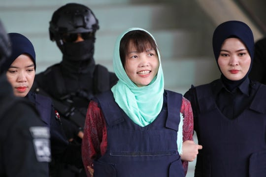 Doan Thi Huong smiles as she is escorted by Malaysian police officers at the Shah Alam High Court in Shah Alam, Malaysia, 01 April 2019. Malaysian prosecutors dropped the murder charge against Doan Thi Huong from Vietnam accused of killing Kim Jong-nam, the half-brother of North Korean leader Kim Jong Un, after she pleaded guilty to the charge of purposely causing injury.