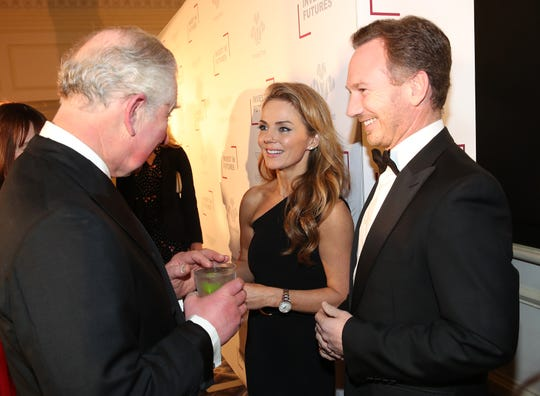 """A representative for Geri Halliwell, seen here at a February 2019 event with Prince Charles and her husband, Formula One team boss Christian Horner, calls bandmate Mel B's declaration that the two had sex in the 1990s """"simply not true"""" and """"very hurtful to her family."""""""