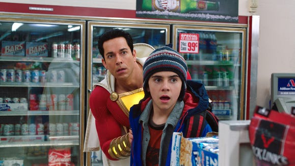 "Super-sized Billy Batson (Zachary Levi, left) and Freddy Freeman (Jack Dylan Grazer) run into robbers on a mission to buy beer in ""Shazam!"""
