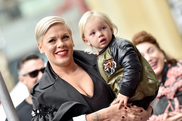 Pink fires back at critics' comments about circumcision after posting photo of son without diaper.