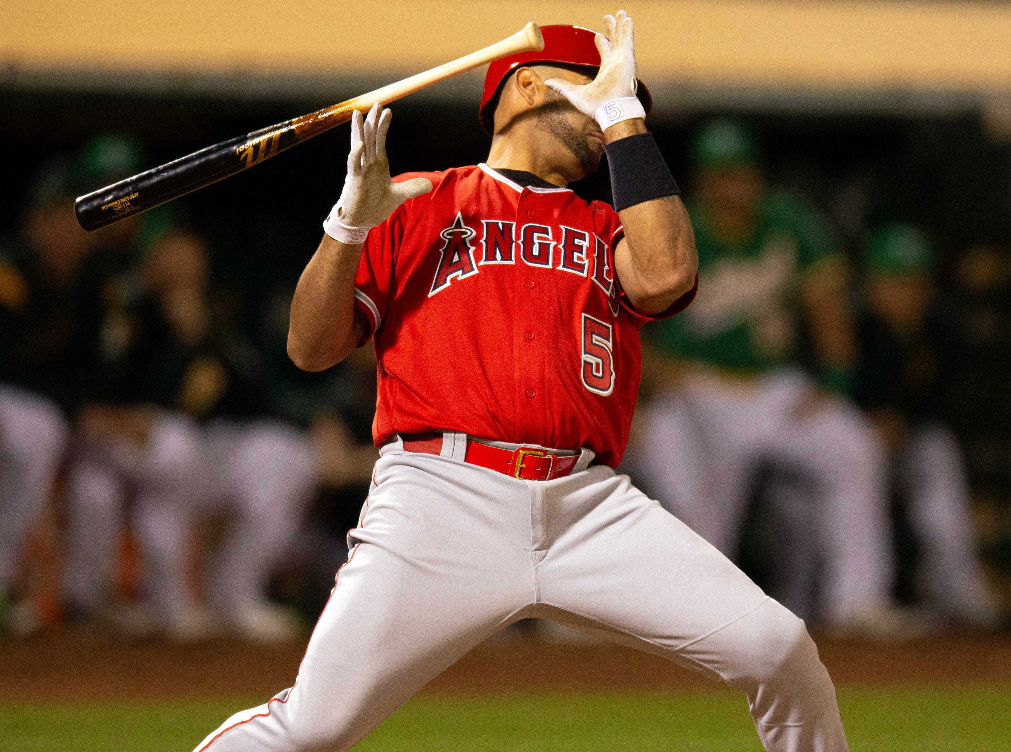 March 29: Angels designated hitter Albert Pujols tries to get out of the way of a pitch against the Athletics.