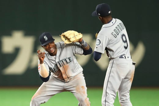 March 20: Mariners shortstop Tim Beckham and second baseman Dee Gordon celebrate after winning against the Athletics in Tokyo.
