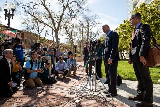 Attorney Michael Avenatti, second from right, talks to reporters after a hearing, Monday, April 1, 2019, in Santa Ana, California.