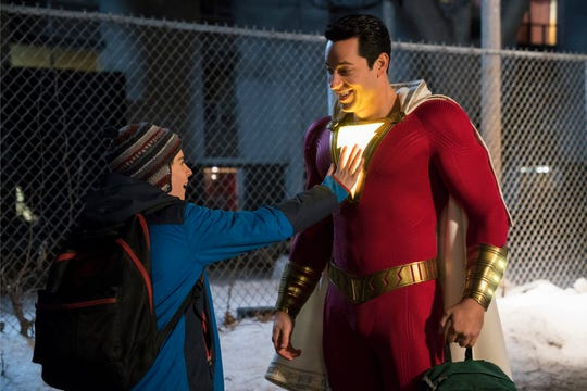 Freddy (Jack Dylan Grazer, left) is wowed by the glowing lightning bolt on the supersuit worn by Shazam (Zachary Levi).