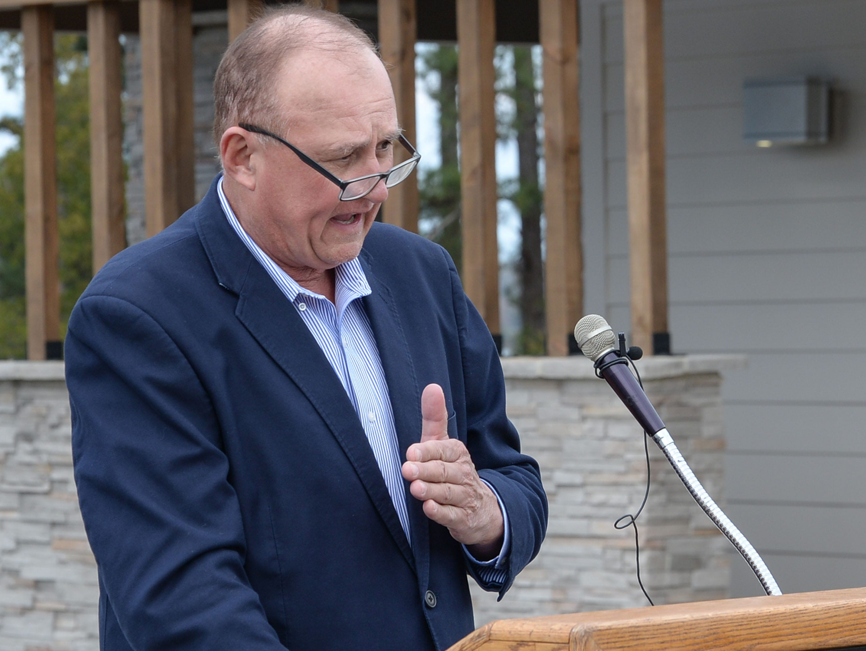 Chairman Tommy Dunn, Anderson County Council, speaks during the Green Pond Landing & Event Center Facilities ribbon cutting event in Anderson Tuesday.