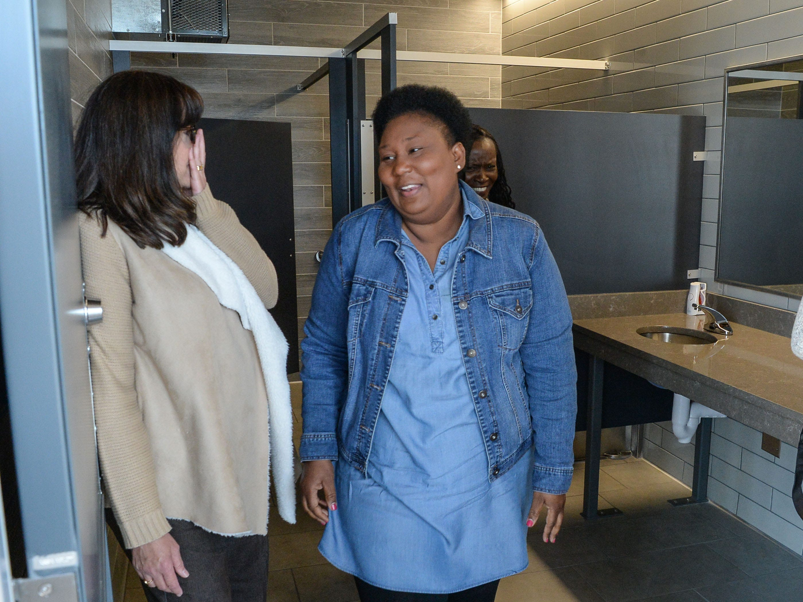 Janice Hopkins, left, of Anderson and Nannette Jackson, right, BASSMASTER tournament manager administration, check out the newly opened bathroom after the Green Pond Landing & Event Center Facilities ribbon cutting event in Anderson Tuesday.