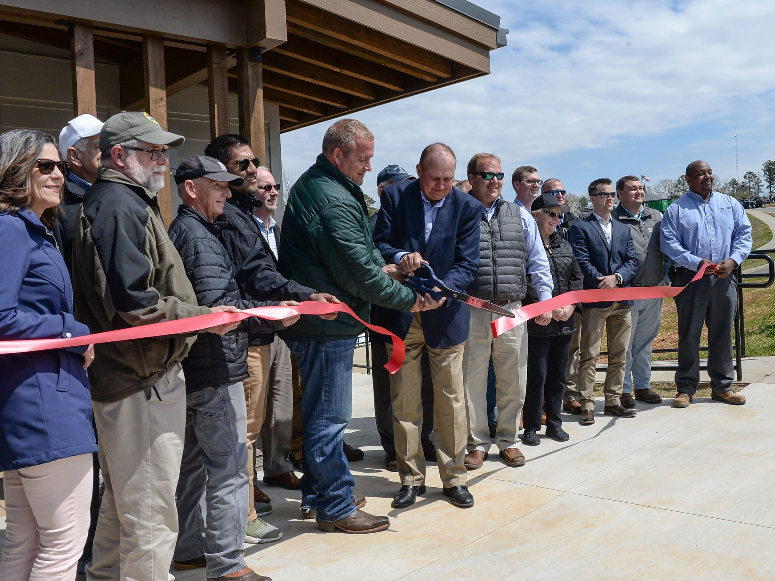 Matt Schell, left, Anderson County Parks Department Manager,  and Tommy Dunn, Chairman of the Anderson County Council cut the ribbon during the Green Pond Landing & Event Center Facilities opening in Anderson Tuesday.