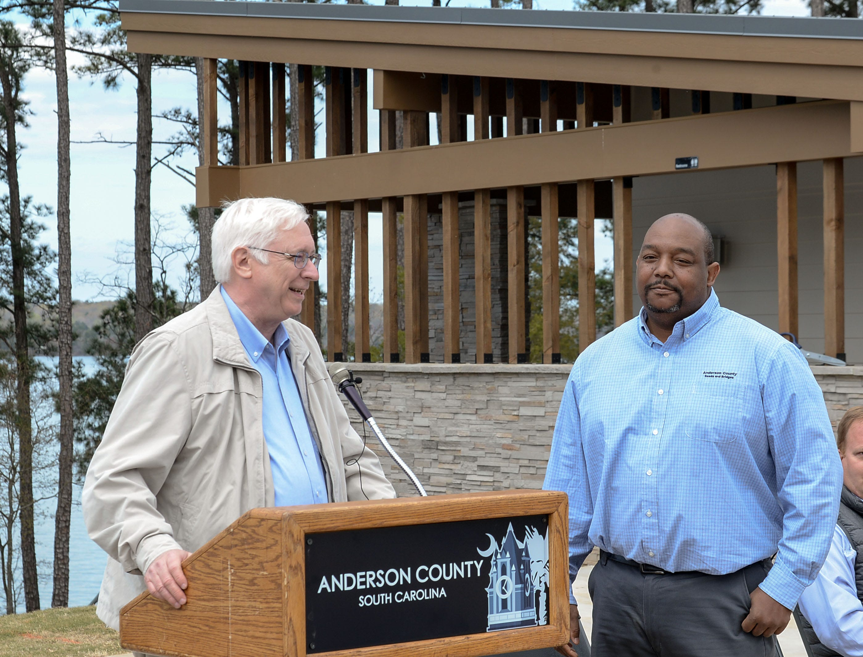 Holt Hopkins, left, Anderson County Public Works director, speaks near Chris Robinson, director of Roads and Bridges, during the Green Pond Landing & Event Center Facilities ribbon cutting event in Anderson Tuesday.