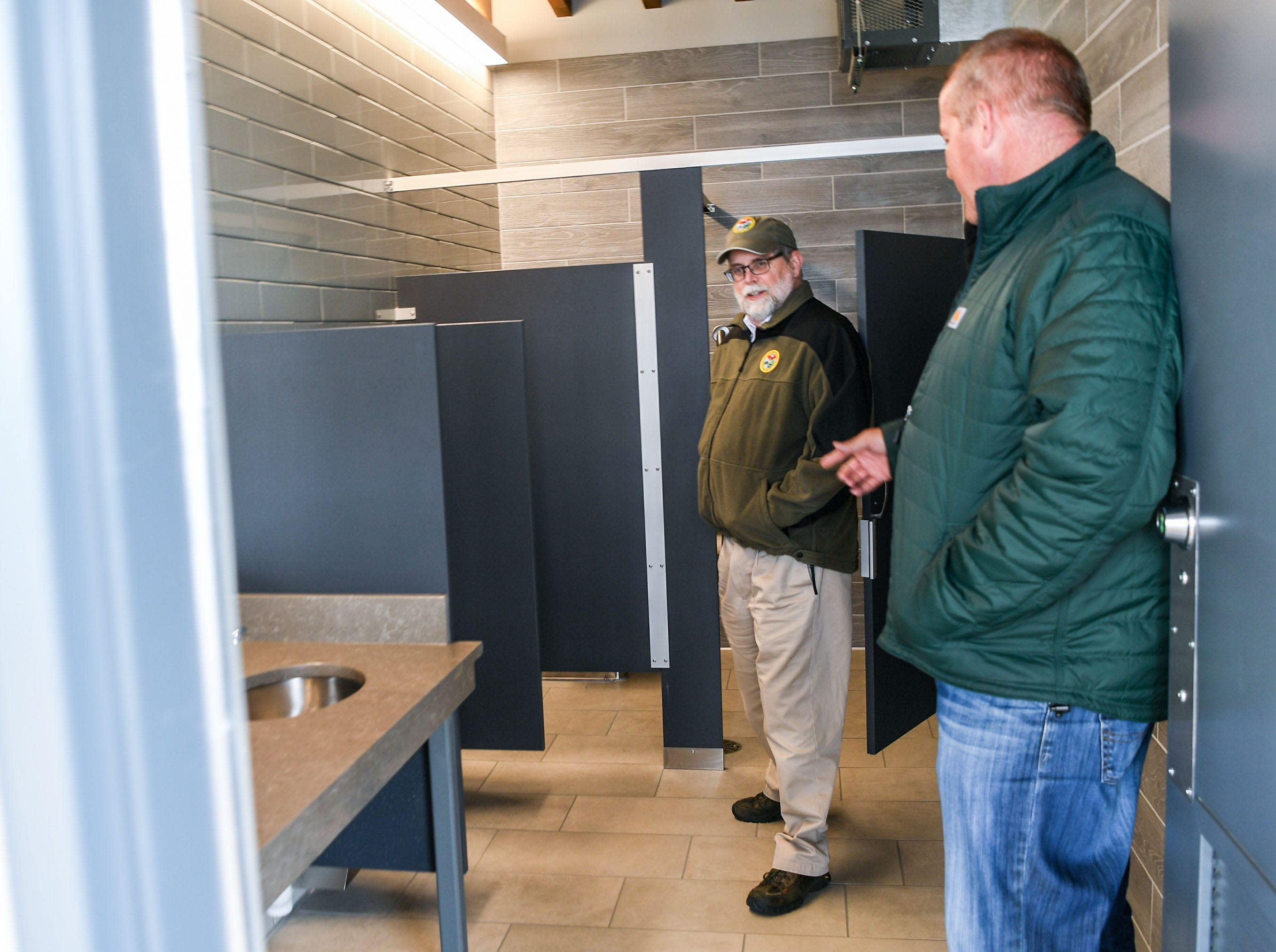 Ross Self, left, of South Carolin Department of Natural Resources, and Matt Schell, right, Anderson County Parks Department Manager, look at the newly opened restrooms at the Green Pond Landing & Event Center in Anderson County Tuesday.