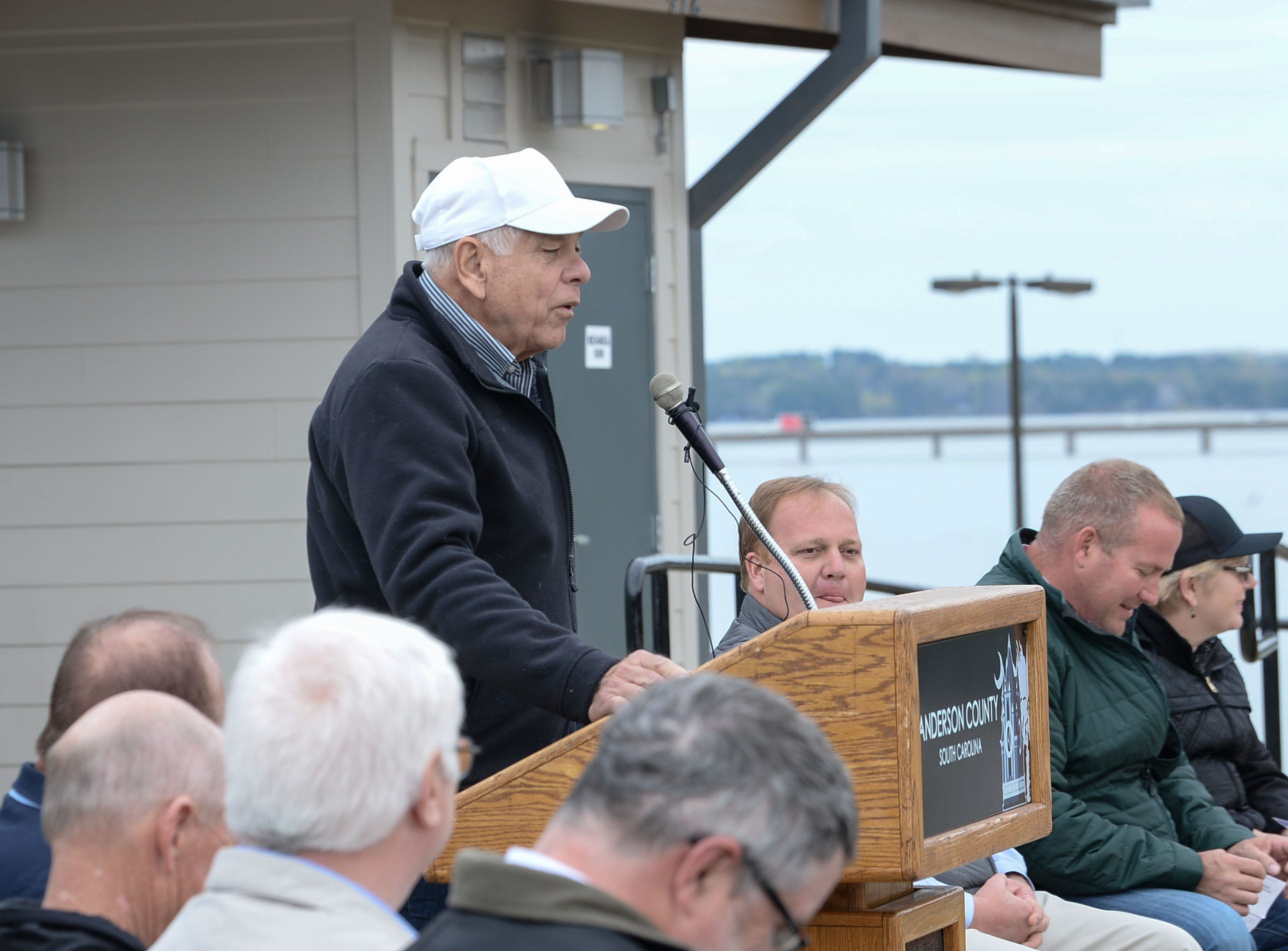 Tom Allen offers the invocation before the Green Pond Landing & Event Center Facilities ribbon cutting in Anderson Tuesday.
