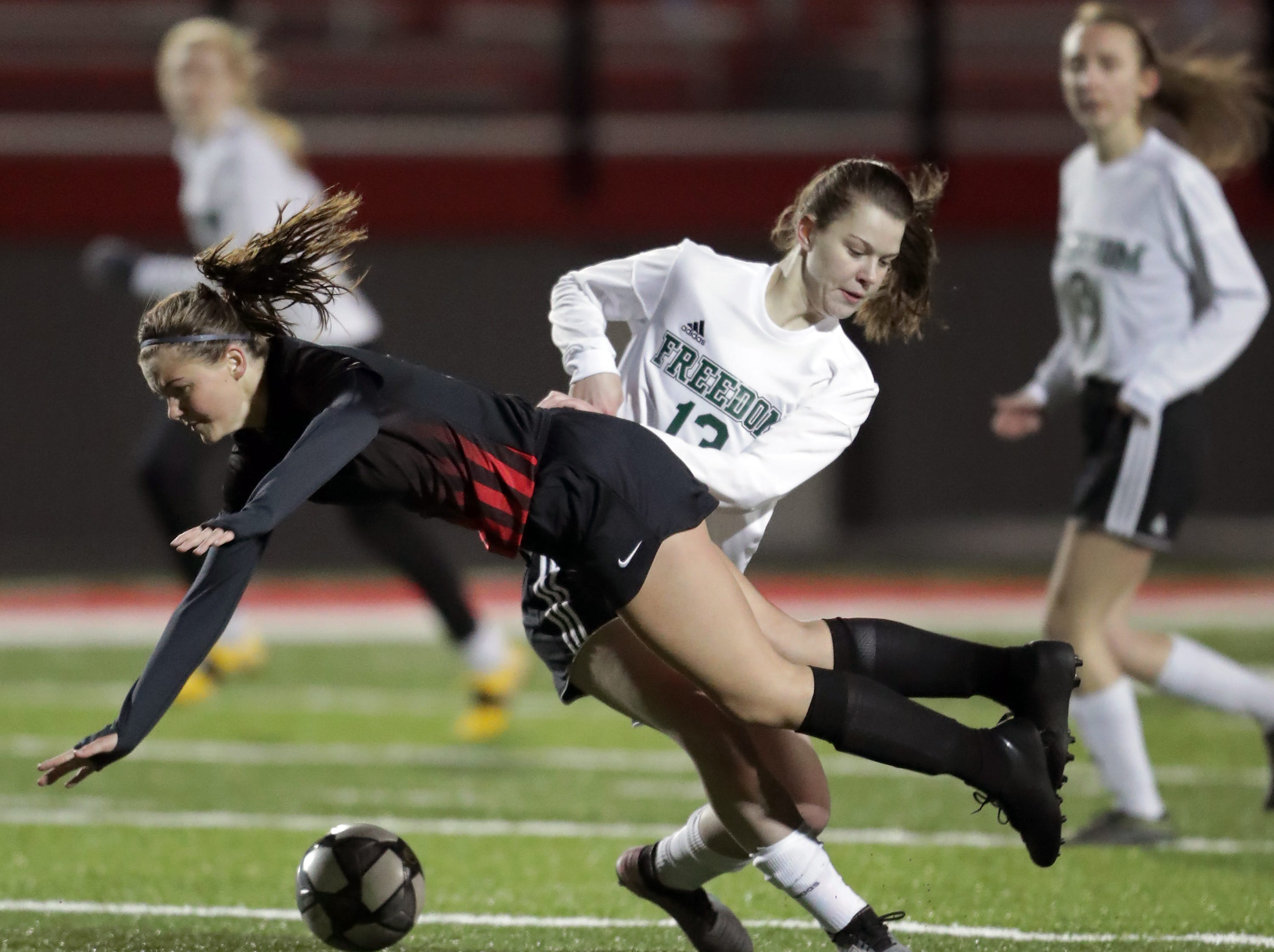 Hortonville High School's #15 Bailey Greisbach against Freedom High School's #13 Hannah Lornson during their girls soccer game on Tuesday, March 26, 2019, in Hortonville, Wis. Freedom defeated Hortonville 3 to 0.Wm. Glasheen/USA TODAY NETWORK-Wisconsin.