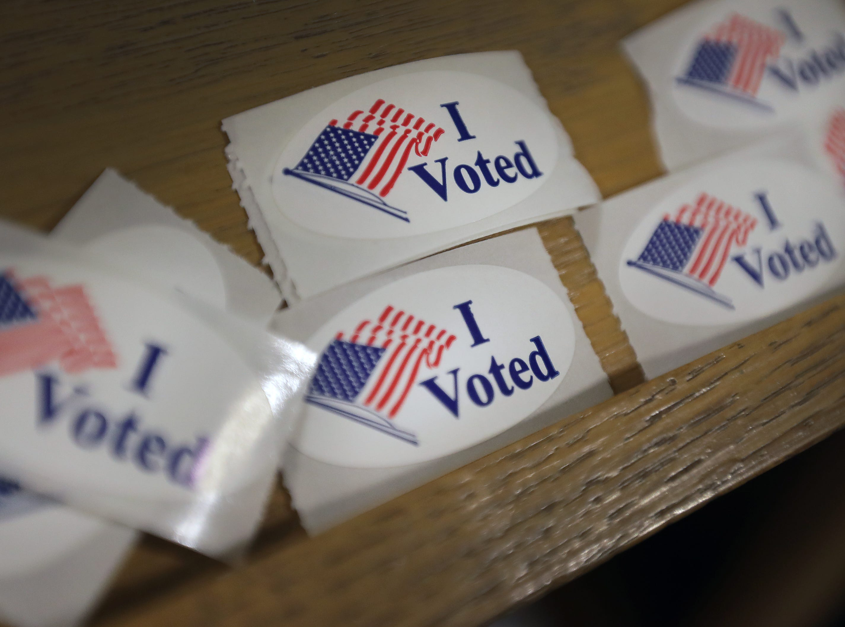 Voters head to the polls at Peace Lutheran Church on Tuesday, April 2, 2019, in Neenah, Wis.