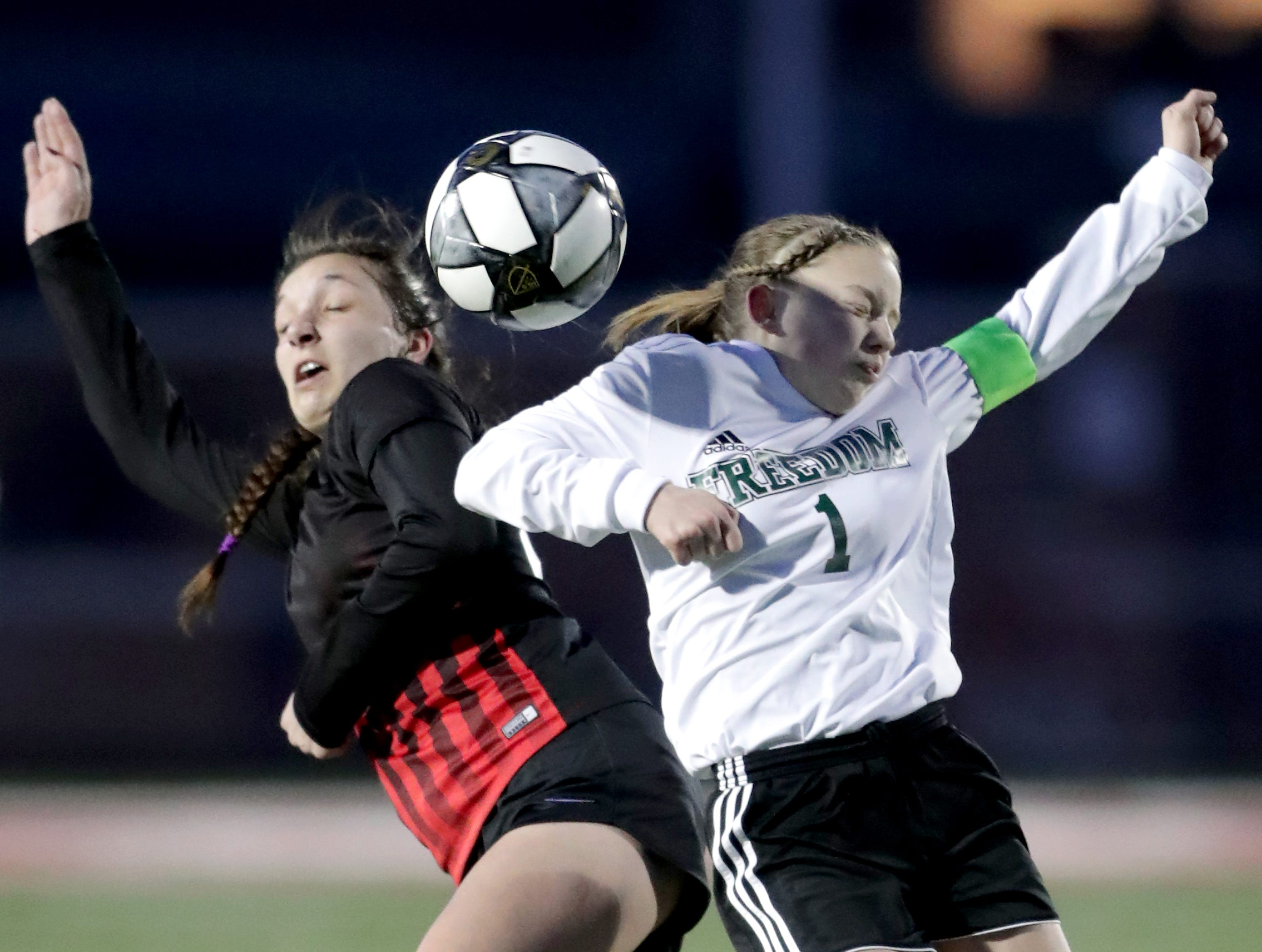 Hortonville High School's #22 Amelia Linder against Freedom High School's #1 Rosa Lezotte during their girls soccer game on Tuesday, March 26, 2019, in Hortonville, Wis. Freedom defeated Hortonville 3 to 0.Wm. Glasheen/USA TODAY NETWORK-Wisconsin.