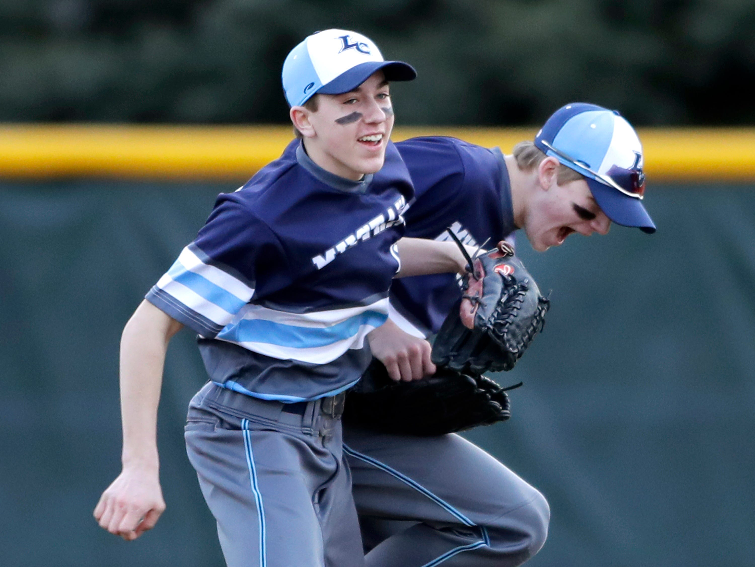 Little Chute High School's #15 Jacob Weigman, left, and #6 Nolan Lamers against St. Mary Catholic High School during their baseball game on Friday, March 29, 2019, in Neenah, Wis. Little Chute defeated St. Mary Catholic 2 to 1.Wm. Glasheen/USA TODAY NETWORK-Wisconsin.