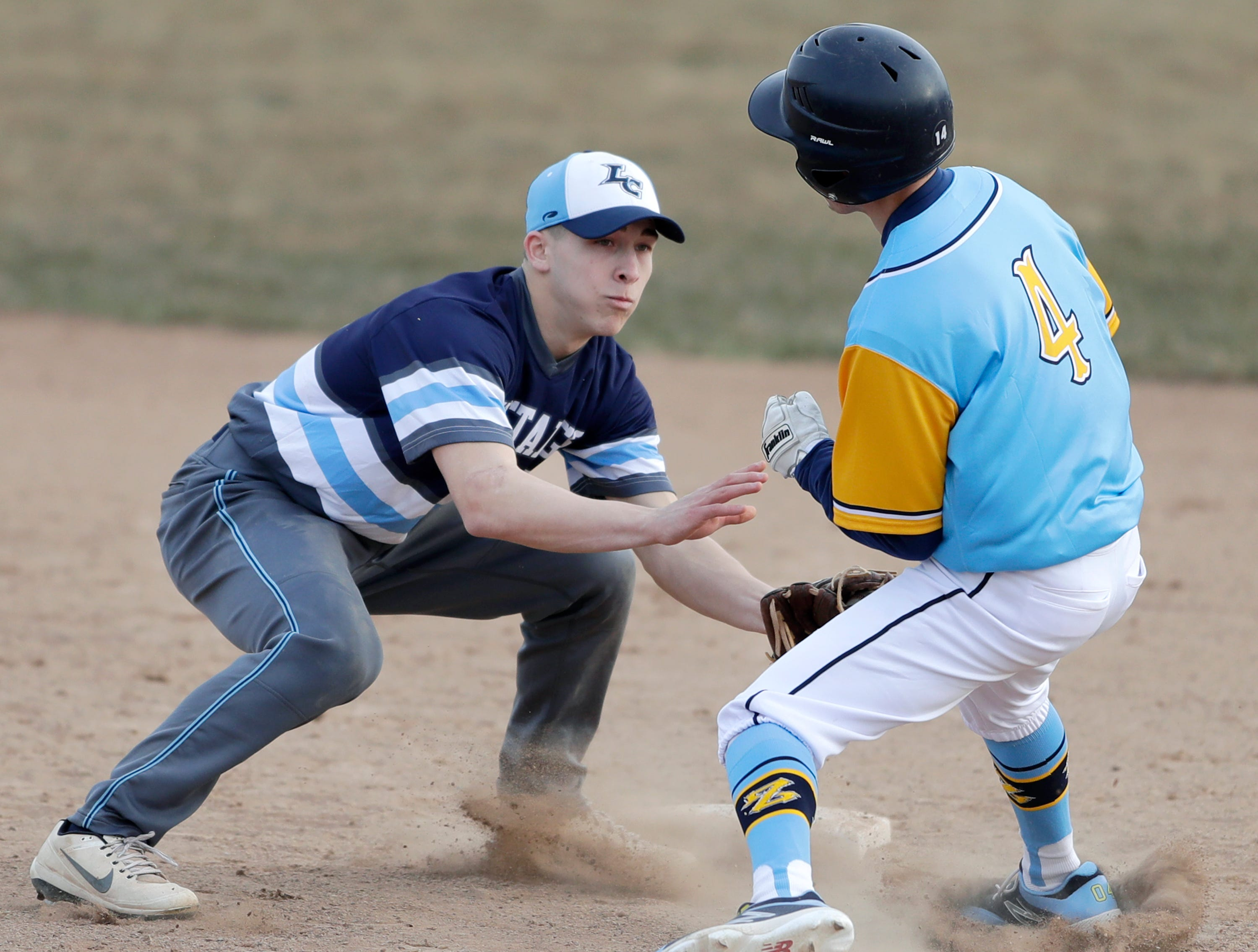 Little Chute High School's #21 Isaac Vandeurzen tags St. Mary Catholic High School's #4 Drew Zimmer at second base during their baseball game on Friday, March 29, 2019, in Neenah, Wis. Little Chute defeated St. Mary Catholic 2 to 1.Wm. Glasheen/USA TODAY NETWORK-Wisconsin.