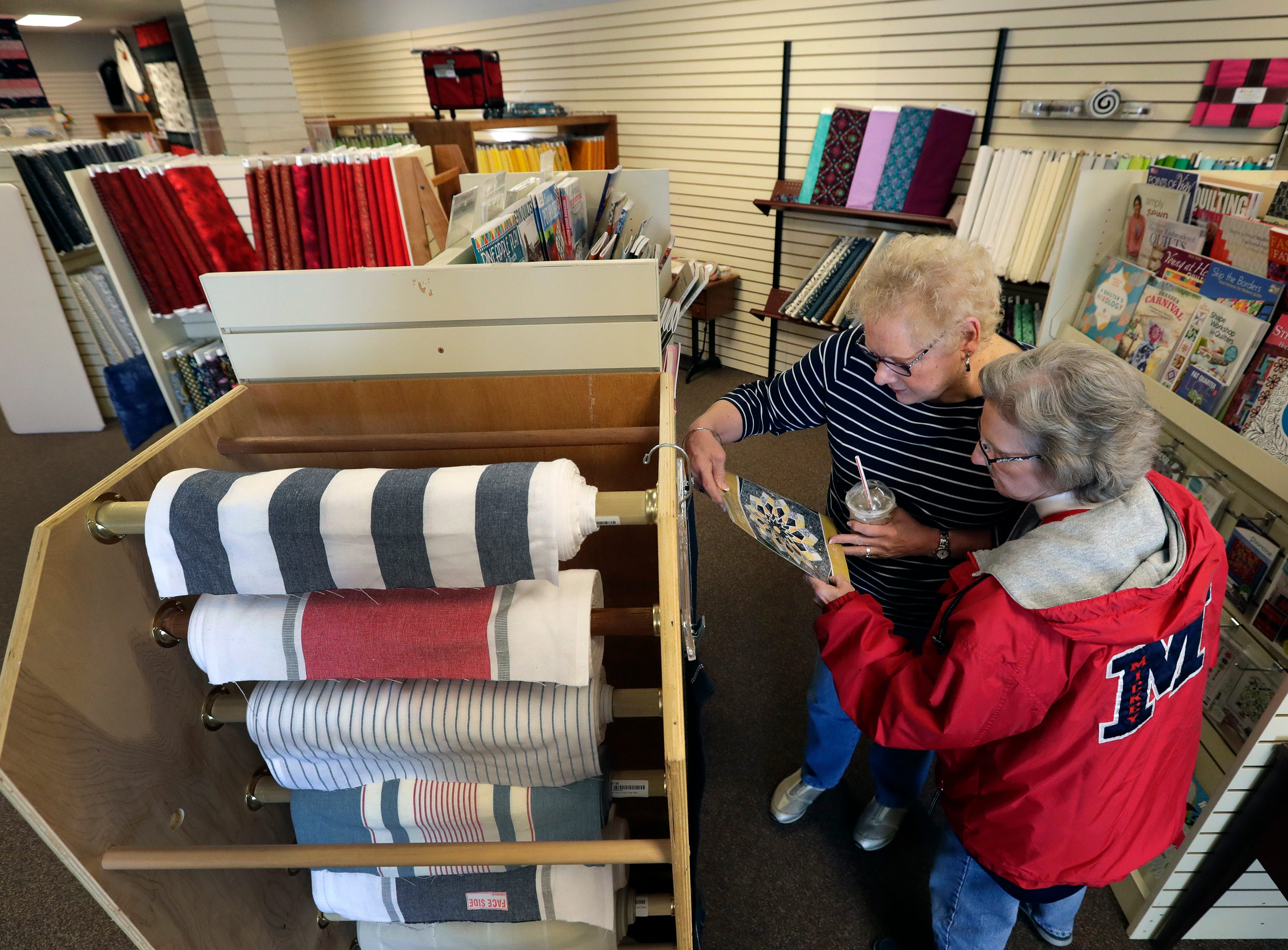 Kathy Eisenschink, left, and Linda Pristelski check out new products Tuesday, March 26, 2019, at Fox Cities Quilt Co., in Appleton, Wis. The two are both from Green Bay.Dan Powers/USA TODAY NETWORK-Wisconsin
