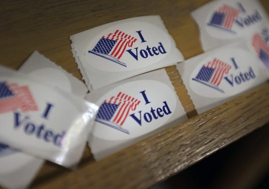 "Electors can take an ""I Voted"" sticker after casting their ballot."