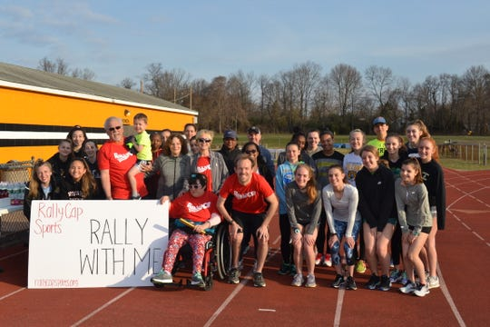 Members of the Monmouth Regional High School girls track team join the Reagan family on their 16-mile walk for Rally Cap Sports.