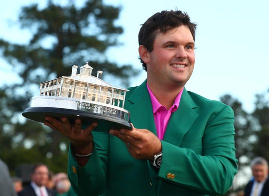 Patrick Reed holds up the trophy after winning the Masters golf tournament at Augusta National Golf Club.