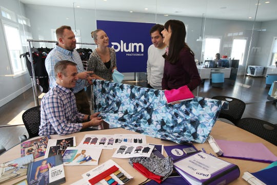 (L-R) Gennaro Palladino, managing partner and CFO, John Mytschenko, partner and director of manufacturing, Lauren Massamillo, marketing manager and Keith and Debra Rizzi, owners of Plum Practicewear, an online retailer of gymnastics and dance apparel that was established in 2009, display some of their products during a team meeting at their office in Spring Lake Heights, NJ Tuesday, April 2, 2019.