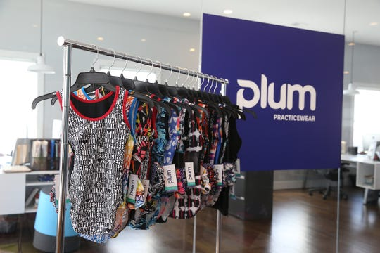 Debra and Keith Rizzi, owners of Plum Practicewear, an online retailer of gymnastics and dance apparel that was established in 2009, display some of their products at their office in Spring Lake Heights, NJ Tuesday, April 2, 2019.
