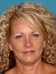 Kimberly Atkinson, 50, of Stafford has been charged with failure to make required disposition of property. The contractor is alleged to have taken money from superstorm Sandy victims whose homes were damaged and done little or nothing on those homes. She was also charged with theft by deception in connection with a mortgage application.