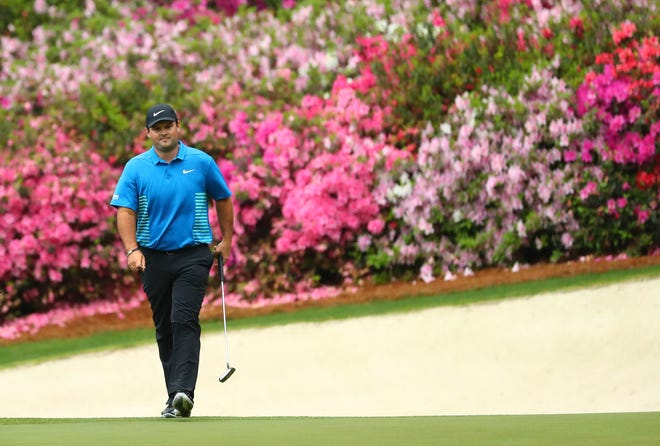 Patrick Reed walks to the 13th green during the third round of the Masters golf tournament at Augusta National Golf Club.