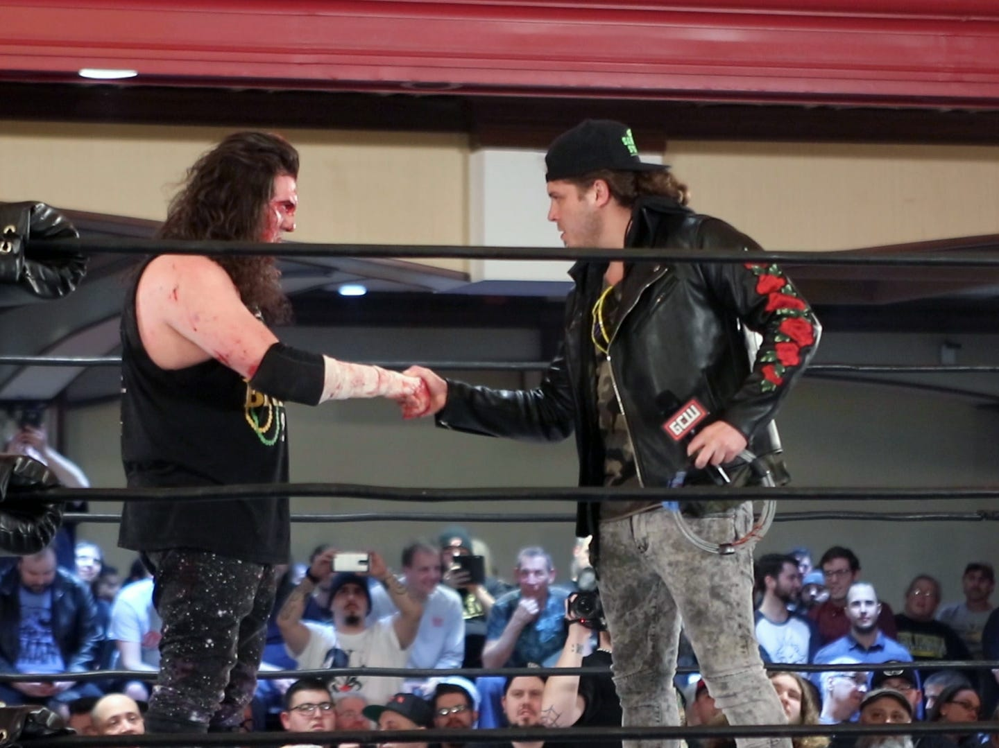 Joey Janela, right, fist bumps Jimmy Lloyd, left, during a Game Changer Wrestling Show at the Showboat Hotel in Atlantic City on Feb. 16. Janela is preparing for his comeback at the annual GCW Joey Janela's Spring Break show, held in Jersey City on April 5 and April 6, after a knee injury last year.