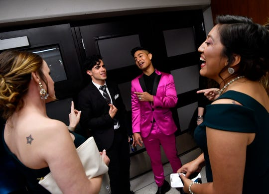"""Actors Nicholas Delgado and Adrian Favela chat with Estefania Hobson (right) and her friends after Saturday's premiere of """"Brother's Keeper"""" at the Abilene Convention Center. The film follows the 2009 championship season for the Abilene High School football team."""