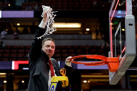 Texas Tech coach Chris Beard holds up the net after the team's win over Gonzaga in the West Regional final in the NCAA men's college basketball tournament Saturday in Anaheim, Calif. Texas Tech won 75-69 to make its first Final Four.