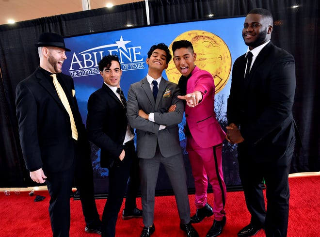 Director Todd Randall laughs as actors Nicholas Delgado, Germain Arroyo and Adrian Favela pose for a group photo with Trom Peterson  at the Abilene Convention Center.
