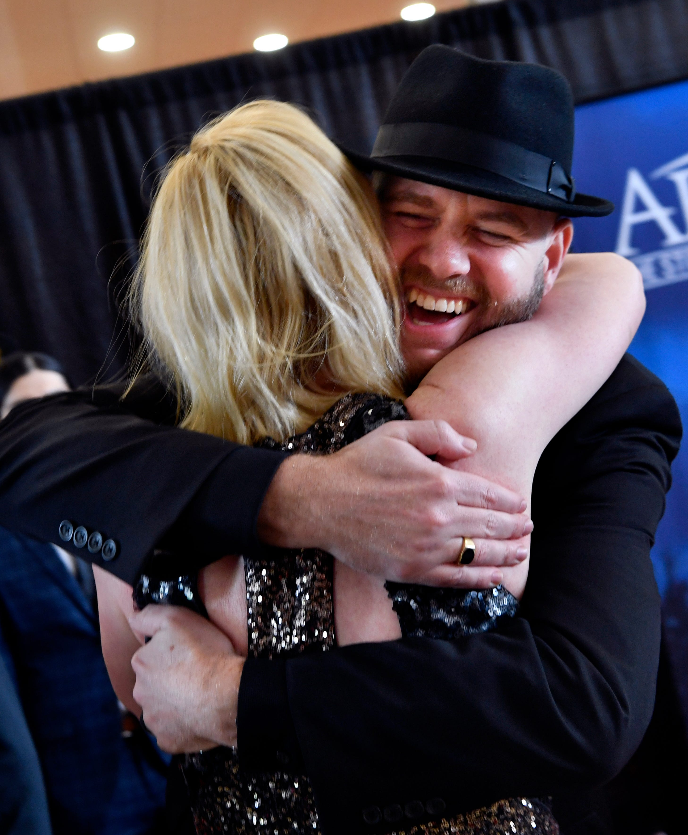 """Director Todd Randall greets actress Abigail Hawk  at the premiere of their film """"Brother's Keeper"""" at the Abilene Convention Center. Hawk played the wife of Chad Mitchell, the chaplain for the Abilene High School Eagles football team."""