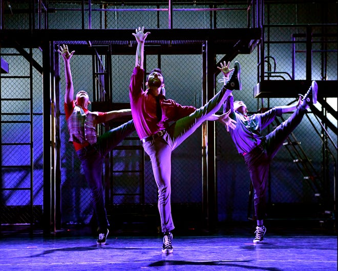 "From left, Luis Villar, D.J. Petrosino and Paulo Gutierrez perform a dance move from ""West Side Story"" during rehearsal Tuesday afternoon at the Paramount Theatre."