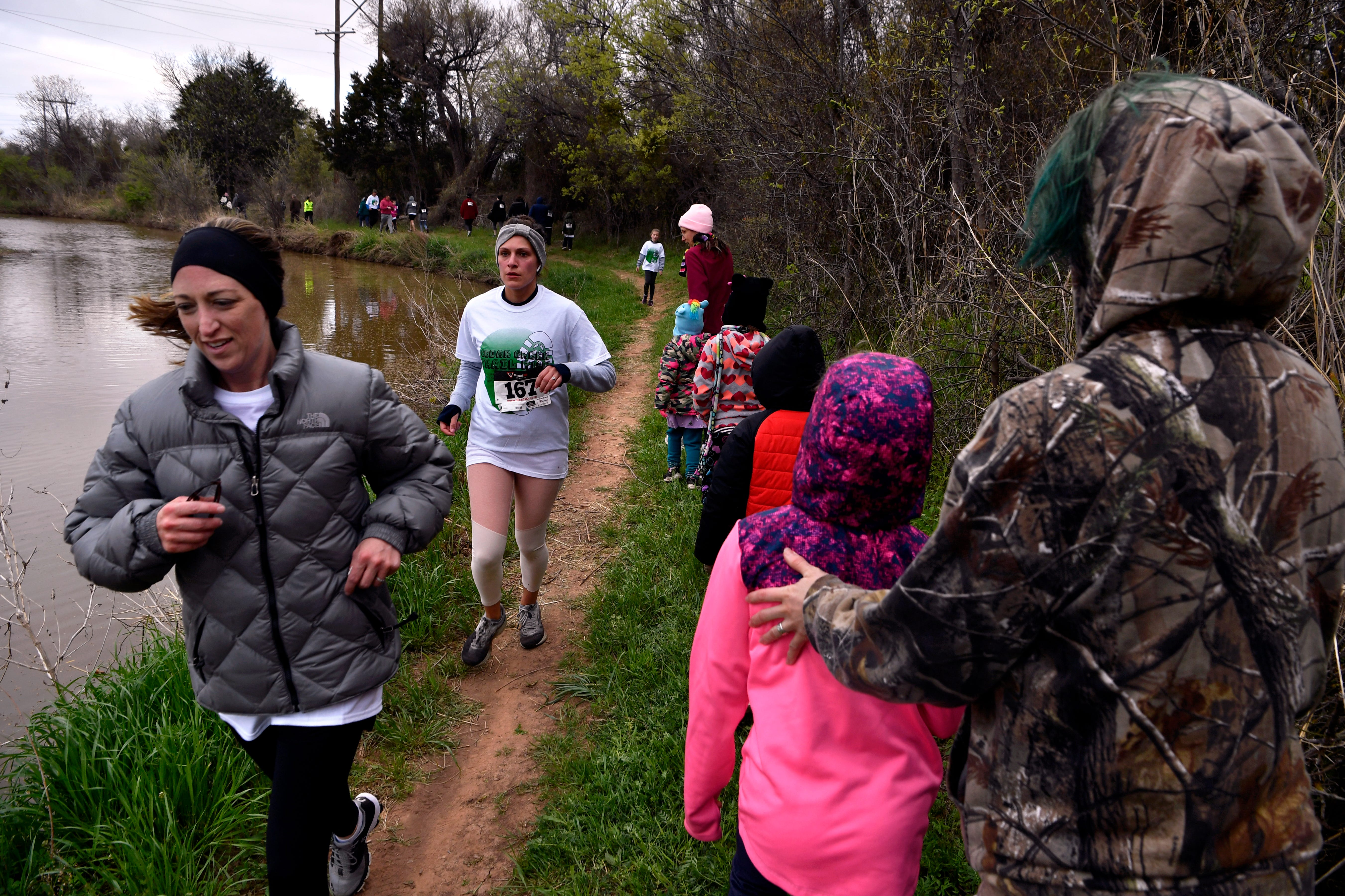 Hikers and some who wished to jog the annual Mayor's Hike pass each other along Cedar Creek Saturday. Water was flowing in the creek, Randy Barnett of the Cedar Creek Waterway said they turn on the effluent water for the hike, which drains into Lake Fort Phantom Hill.