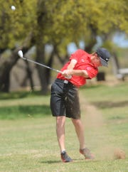 Cooper's Karson Grigsby hits onto the green at 14. The freshman shot 2-over-par 74 to win the two-day District 4-5A tournament with a 144 on Tuesday, April 2, 2019, at Brownwood Country Club.