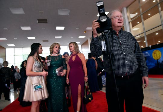 """Russell Peables positions attendees before photographing them in front of the Abilene High School Eagles inflatable Saturday. Hundreds turned out for a gala premiere at the Abilene Convention Center of """"Brother's Keeper."""""""