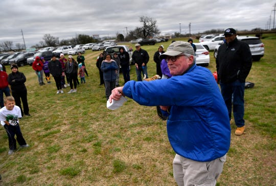 Randy Barnett directs hikers Saturday March 30  before the start of the Mayor's Hike along the Cedar Creek Waterway. At least 100 people braved blustery weather for the 3-mile round-trip stroll along the creek.