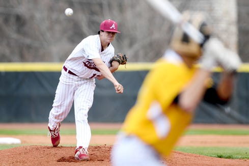 Asheville's Matias Marchesini-Diaz delivers a pitch against Tuscola during their game at Asheville High School on March 29, 2019. The Cougars defeated the Mountaineers 5-4.
