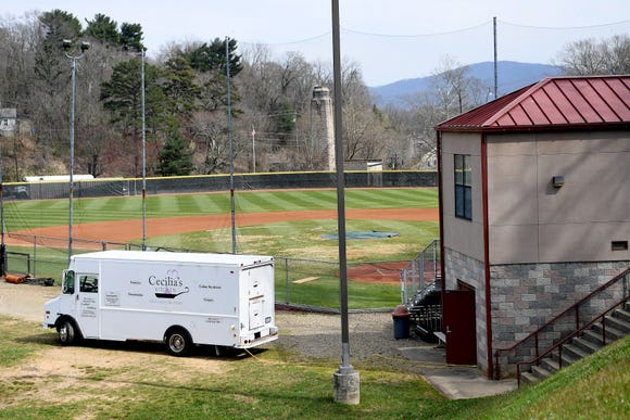 The Cecilia's Kitchen food truck is parked along the third base line at Asheville High School as Cecilia Marchesini prepares to serve food during the game against Tuscola on March 29, 2019.