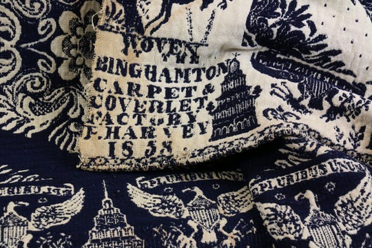 The legend  of the coverlet showing the name of the company, weaver and date.
