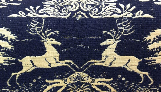 A close-up of the deer used in the pattern of the coverlet.